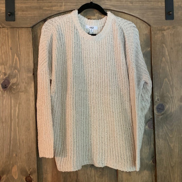 The front of the beautiful Jack Oatmeal Back Button Sweater, which sells at Venue for $78.