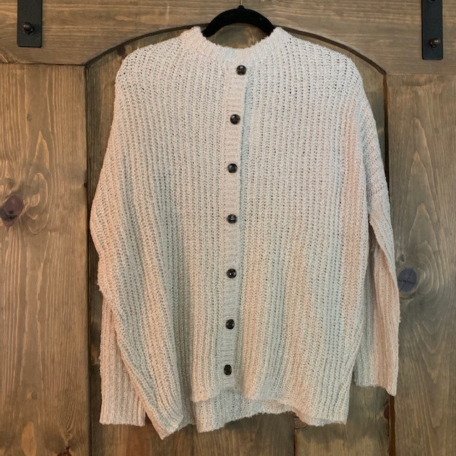 Button up this fall with the $78 Jack Oatmeal Back Button Sweater!