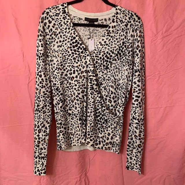 Just a little bit more fun than your typical V-neck! You can pick up the $99 Sanctuary XOXO Leopard Sweater now at Venue!