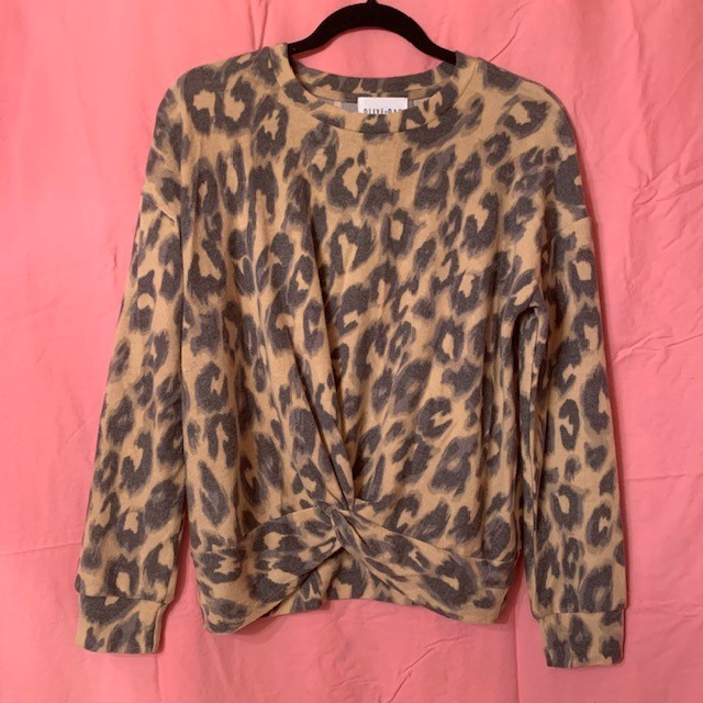 You'll be one cool cat in this sweater. The Olive + Oak Leopard Sweater can be yours for $58!