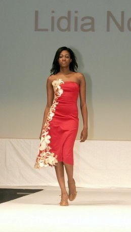 Red strapless dress. Stretchy cotton. Flower applique cut from a complimentary fabric and sewn along entire right side, accented with sequence.