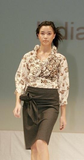 Beige criss-cross blouse and denim pencil skirt.
