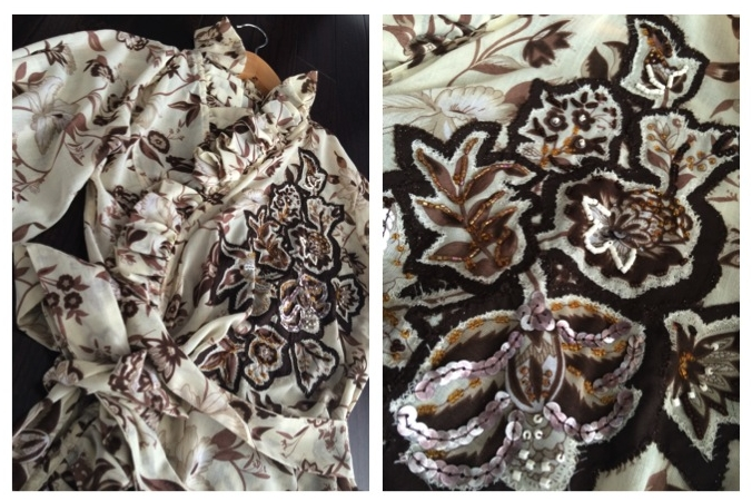 Cream light polyester fabric with brown flower print. Criss-cross design with ruffle along neckline, gathered fabric on left hand panel at waist area. Loose, 3/4 length sleeves. Extra long fabric wrap-around bow tie. Fabric flower applique on left side panel, accented with beads and sequence.