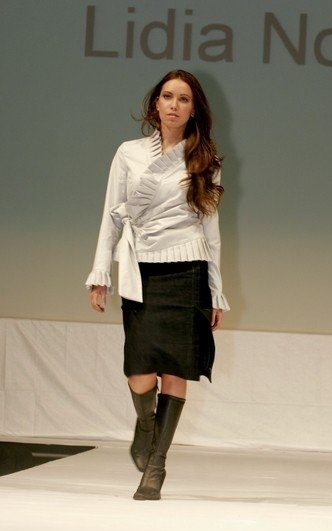 Grey fitted jacket and black pencil skirt.