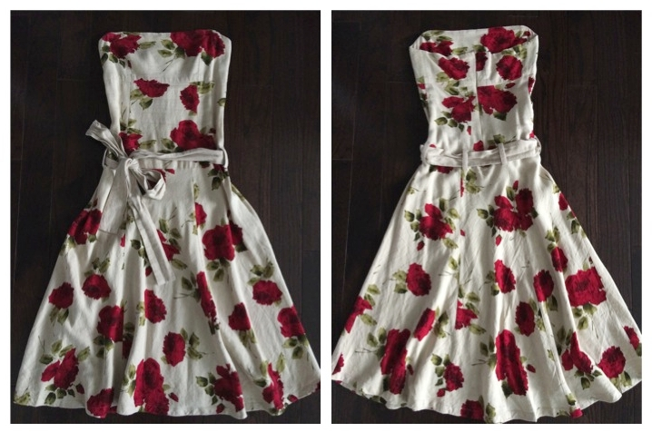 Beige linen fabric with red rose print. Fitted top and A-line skirt. Beige linen tie on lower waist.
