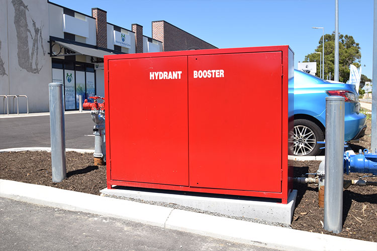 fire-equipment-cabinet-red-and-bollards.jpg