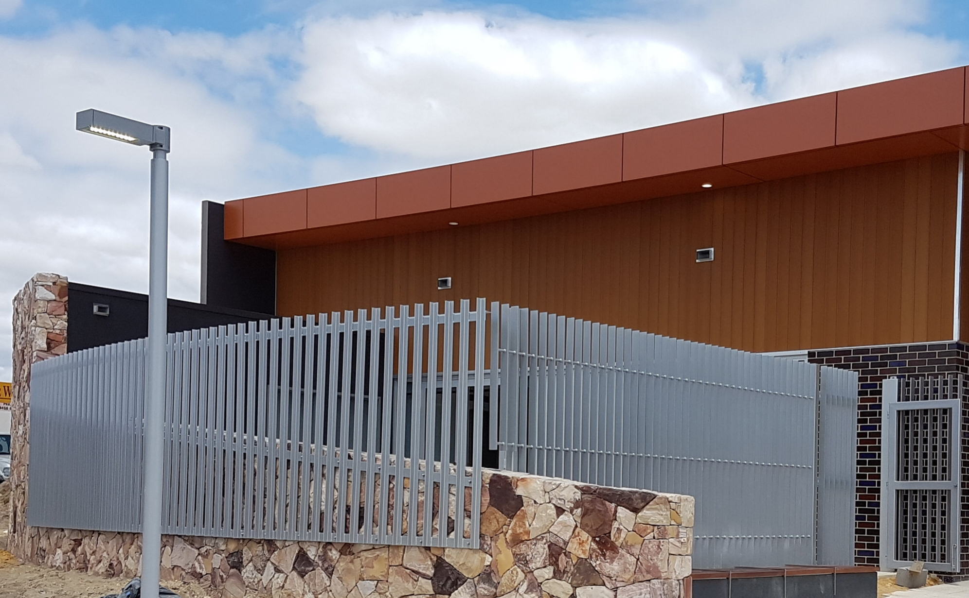 Manning Community hub Pact Construction curved steel fence 1.jpg