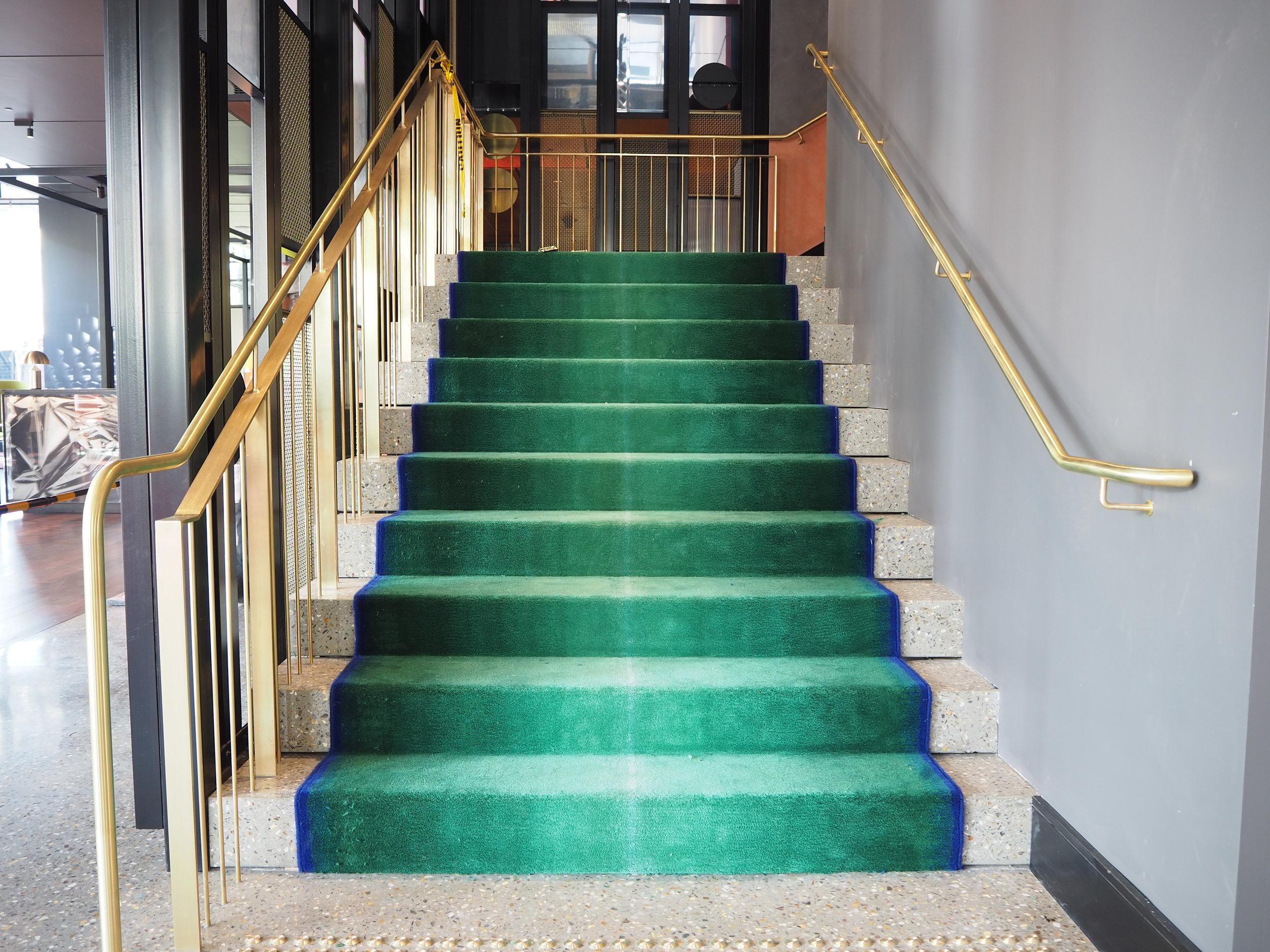 QT Hotel brass balustrade and handrail.JPG