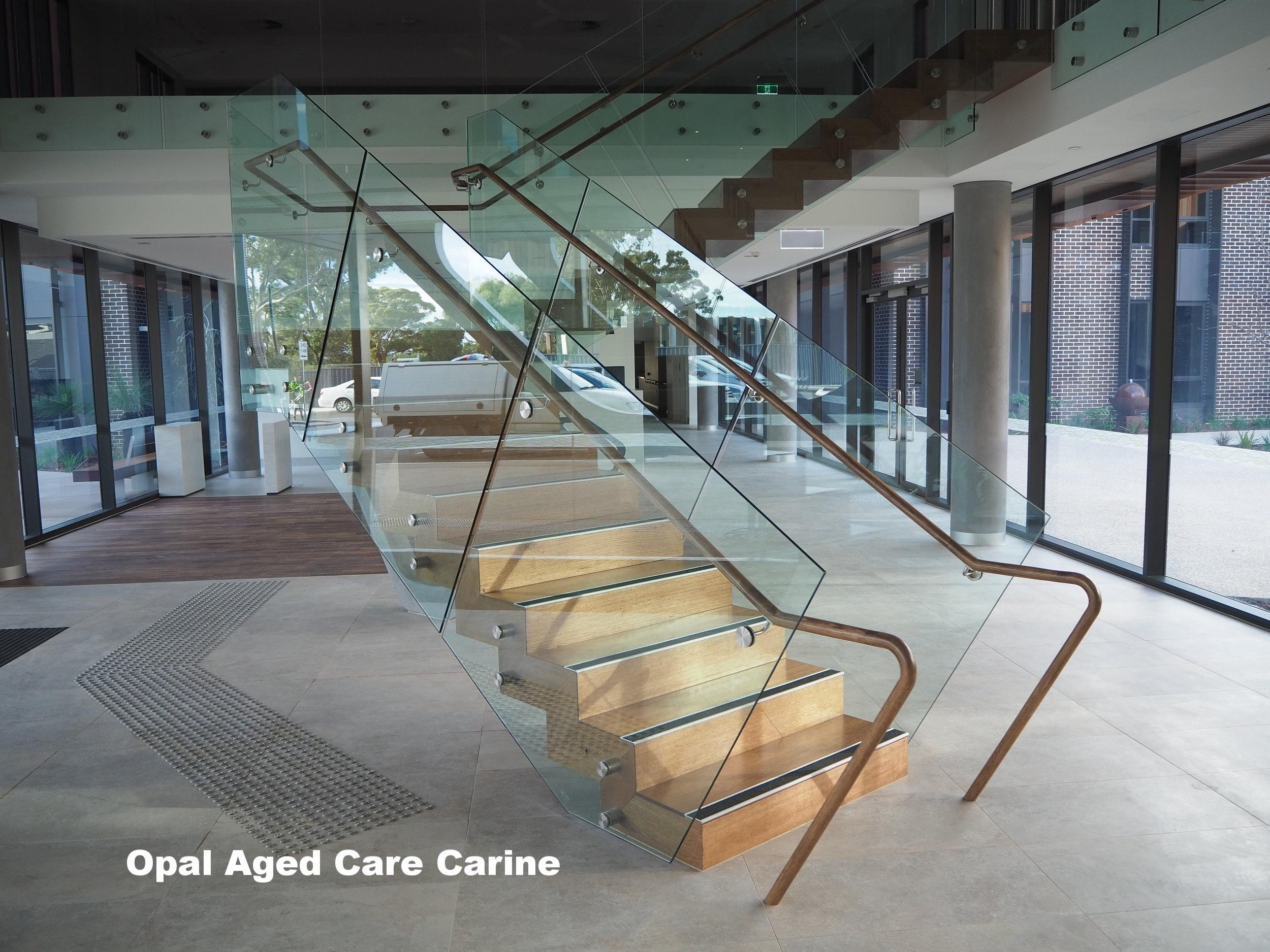 opal carine frameless glass balustrade timber handrail opal aged care carine.JPG