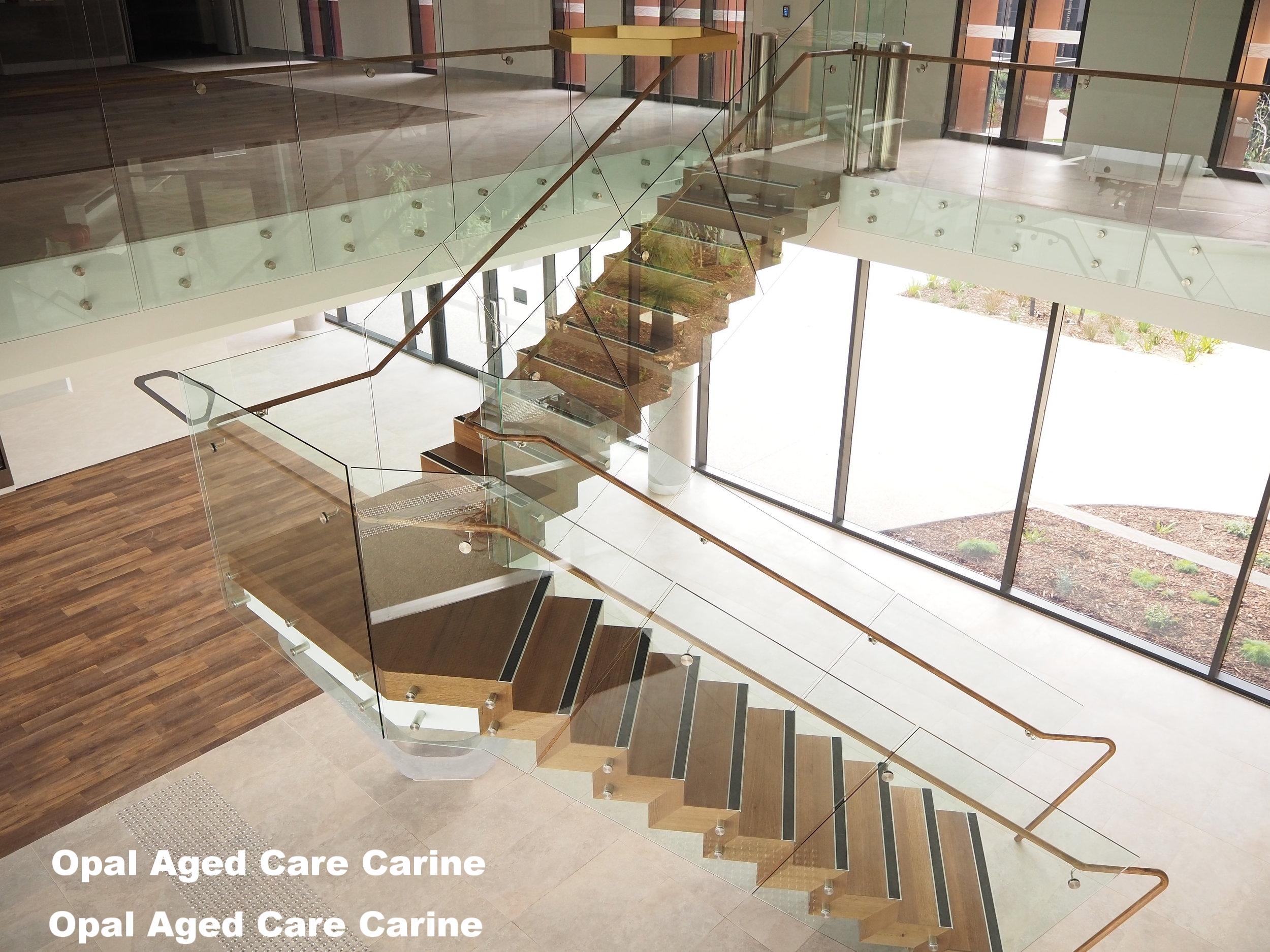 opal carine frameless glass balustrade timber staircase handrail opal aged care carine.JPG
