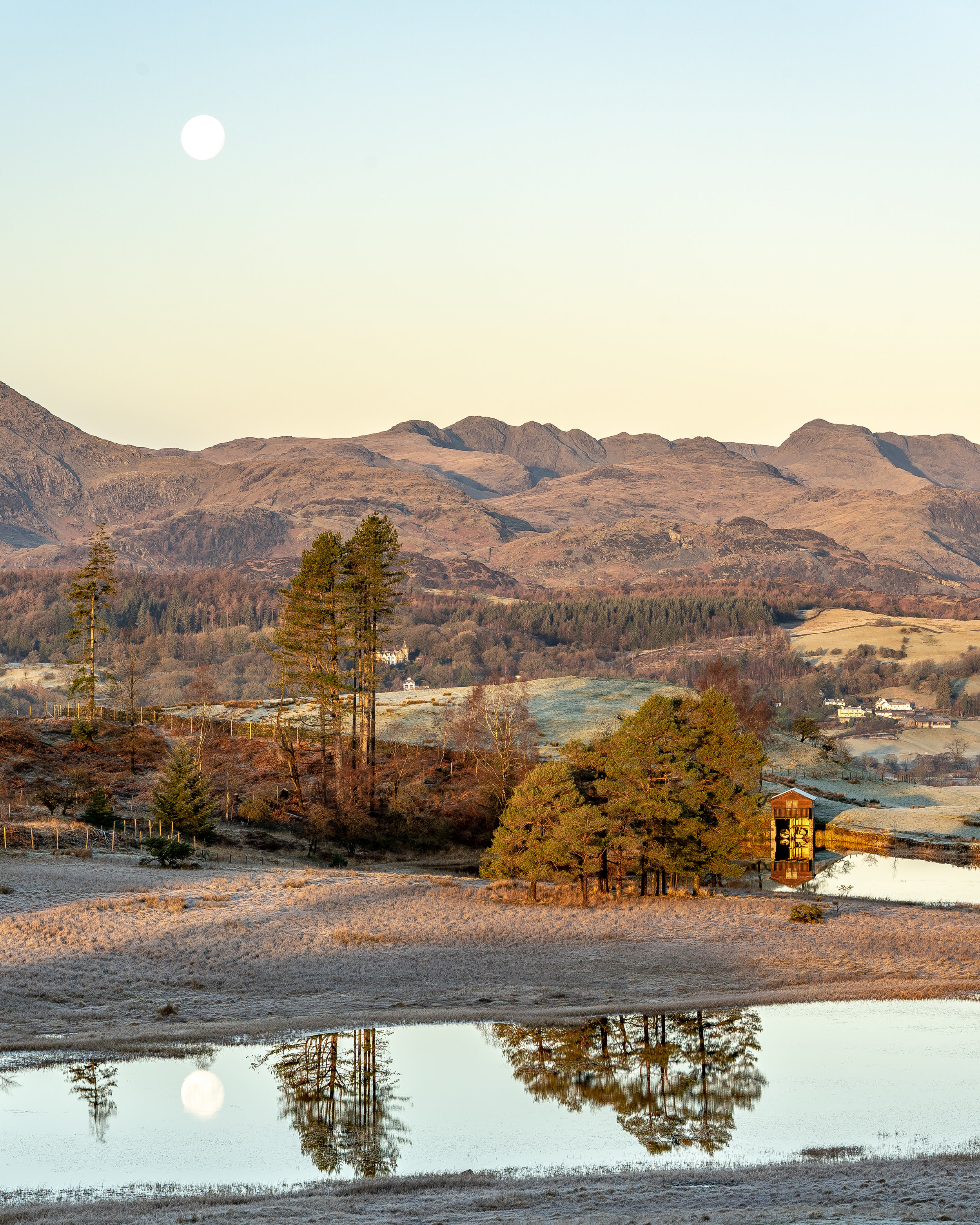 Wise Een Tarn & Crinkle Crags at Sunrise, December 2018   f/11, 1/30 sec, 100mm   Lucky Shot... I was on a different part of the hill when I realised the moon would reflect in the Tarn, so I ran around the hill like a loon with the tripod rig looking for the best composition I could find and took a bunch while the reflection was there. This shot was the first I took, before it fell too low and the reflection was gone. Turned out I had about 2 minutes to grab the shot. By the time I'd finished I realised I couldn't remember where my kit bag was 🤣. (I eventually found it - it was about 200m away!)
