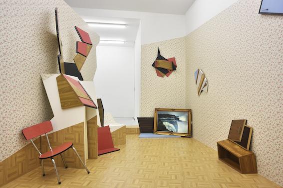The detonate(d) room: Formica furniture, linoleum,  wall paper , wood,chair,installation in situ.