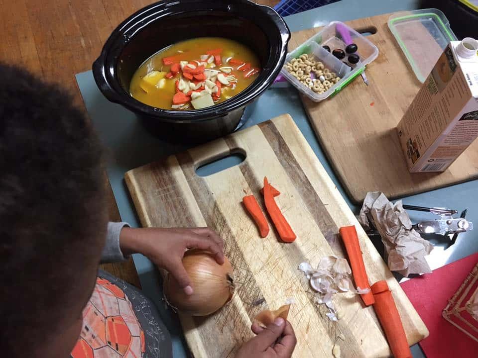 child making soup