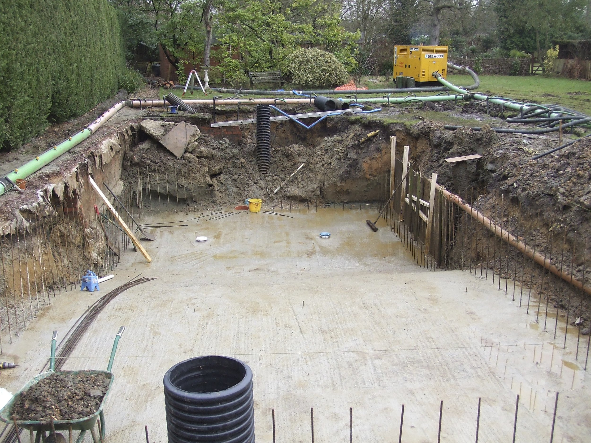 - 2.2 metres deep and we came across an underground stream on this project. Just as well the shell is reinforced with a double layer of steel mesh and shotcrete to a thickness of 200mm and is very well insulated.