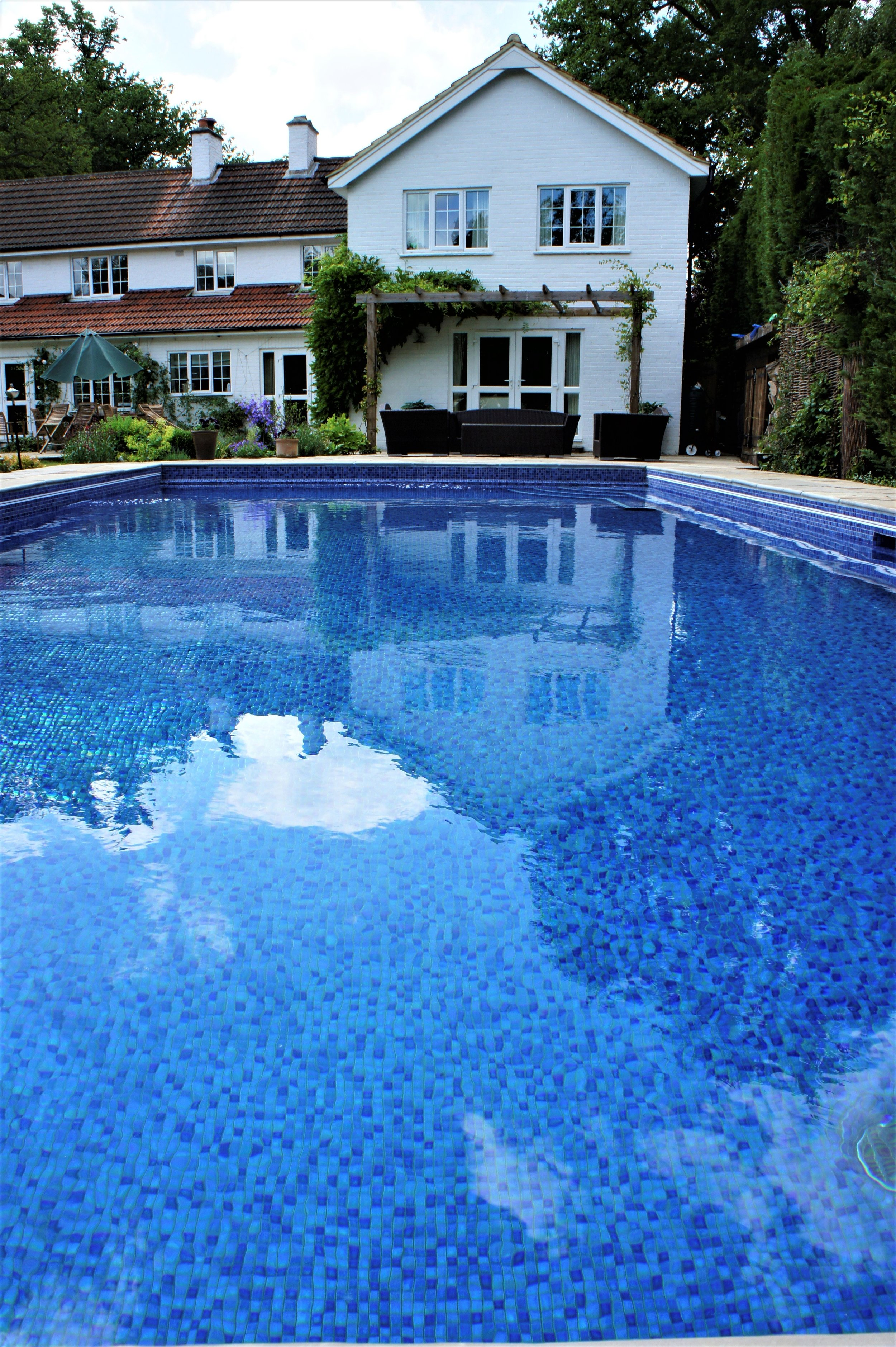 - A stunning traditional skimmer type pool, the deep blue tiles give a sense of depth. A beautiful place to relax & entertain.