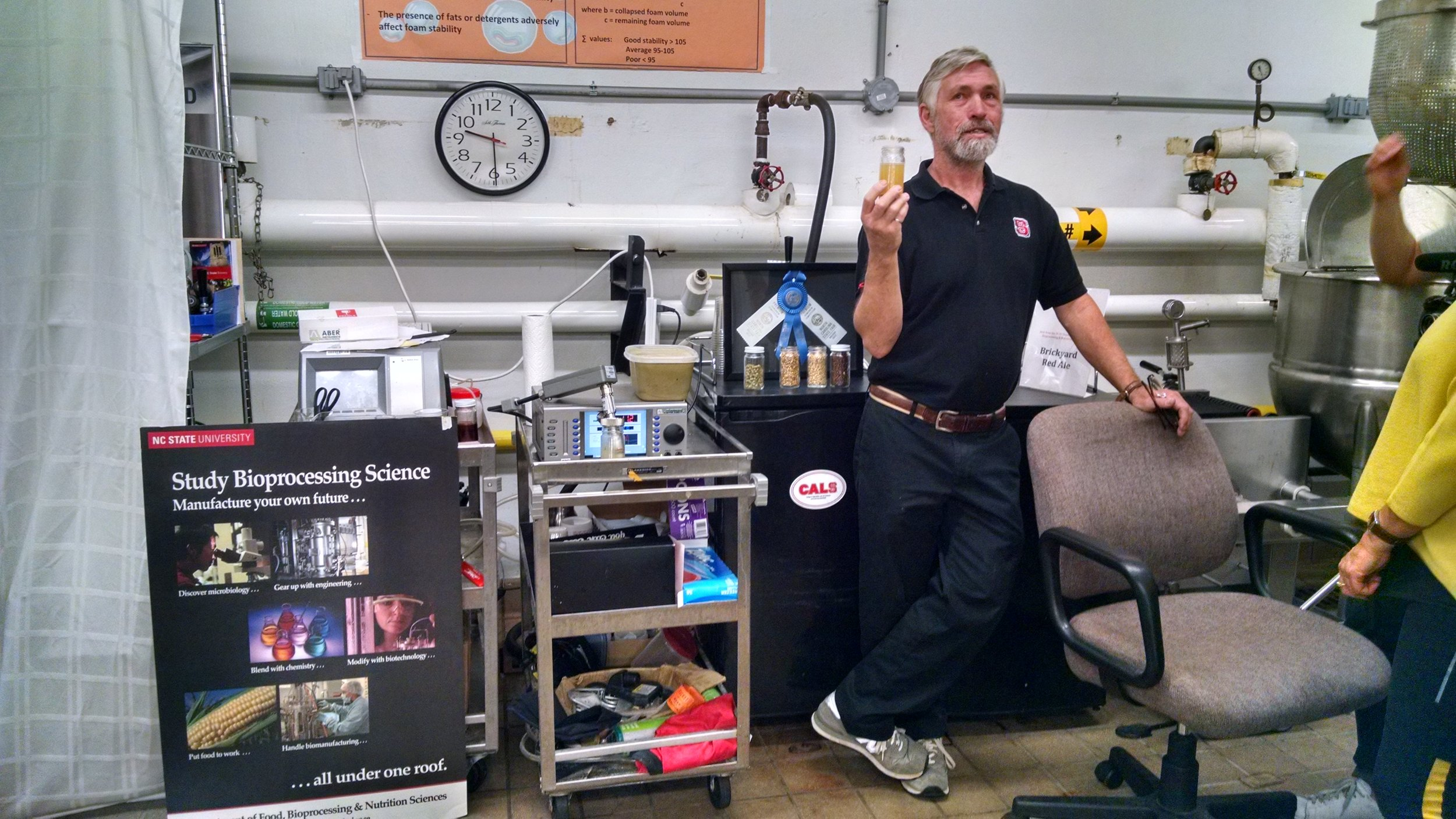 Co-inventor Dr. John Sheppard discussing the story of Wasp Beer with a documentary film crew.