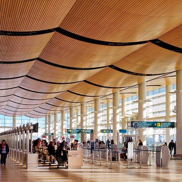 """These beautiful wood canopies helped Winnipeg International Airport win the 2015 Award of Merit for Architecture and be deemed by the Travel Channel as one of the """"Worlds Most Iconic Airports."""" 🎖 ——————————————————— Project: Winnipeg Richardson International Airport, Winnipeg, Canada Architect/Engineer: Stantec (@stantec) Designer: Pelli Clark Pelli (@pcparch) Ceiling Product: Wood Veneer, Linear Open Series (L03) by ACGI ——————————————————— 📨 Contact Design Strategies for details, samples, and more information: @designstrategies"""