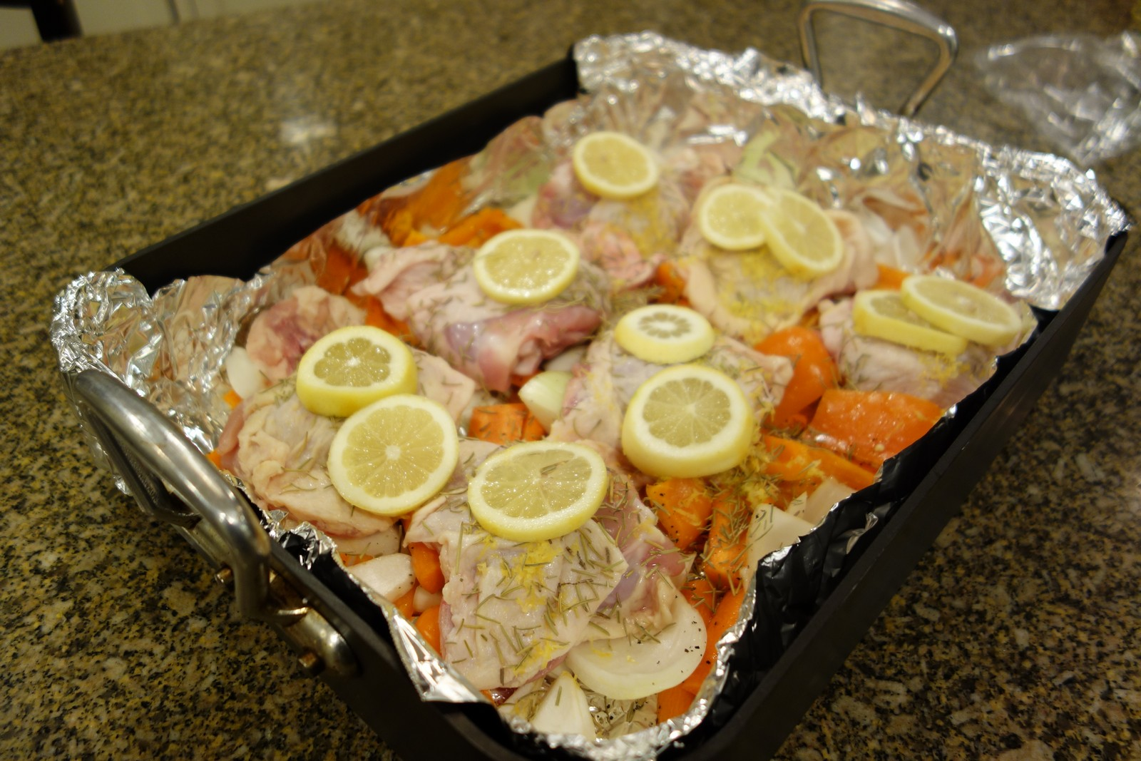 Sprinkle rosemary on top. then squeeze lemons over all of it, and place lemon slices on top.