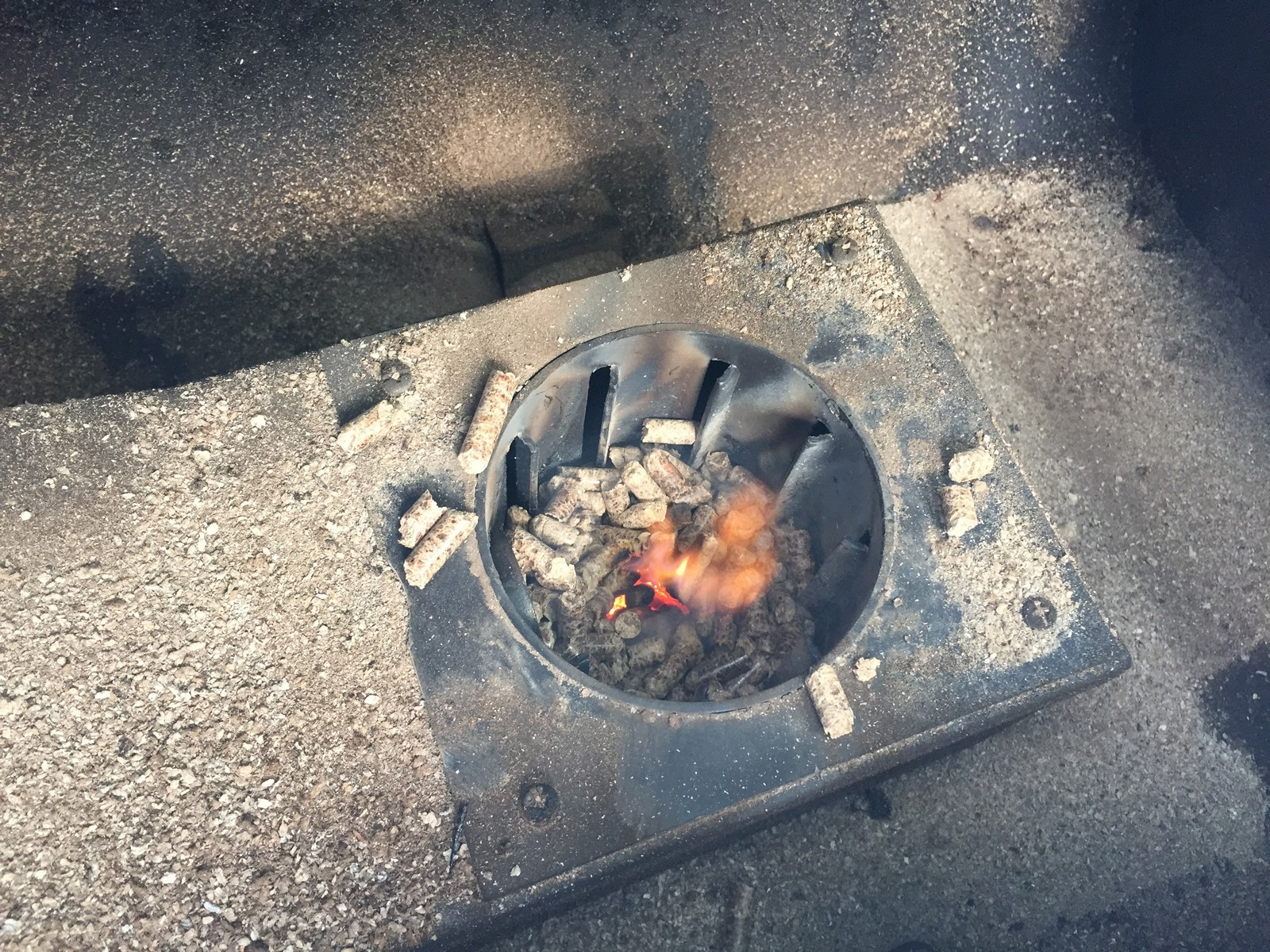 Once the pellets ignite, the flame is varied by feeding more (or fewer) pellets in. The smoker heats up faster than it cools down. You can help it cool down faster by opening the lid.