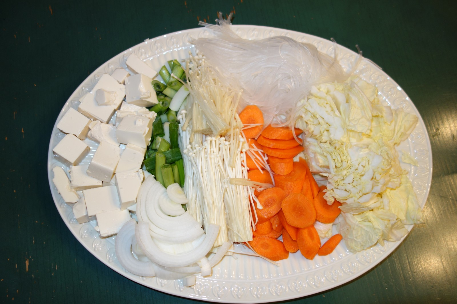 Here's how we prepare the vegetables and noodles for cooking.