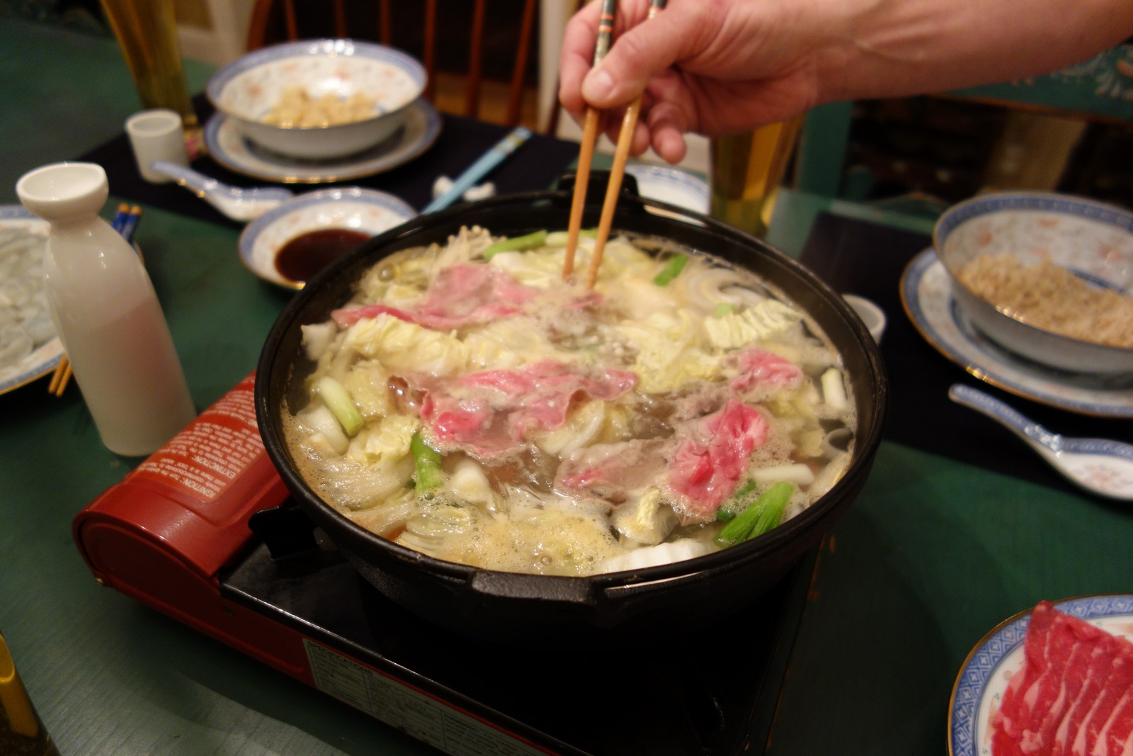 The beef cooks really fast because it is sliced so thin. This makes for a really relaxed pace as you make your way through dinner. If you want more, just put a piece in the pot and it will be done in less than a minute.
