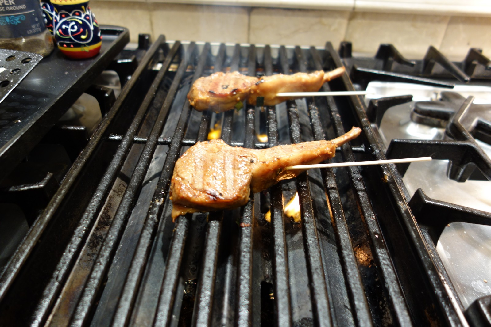 After marinating, skewer and place on the grill with the end of the skewers off the grill . . . so you can safely use them to flip the chops.