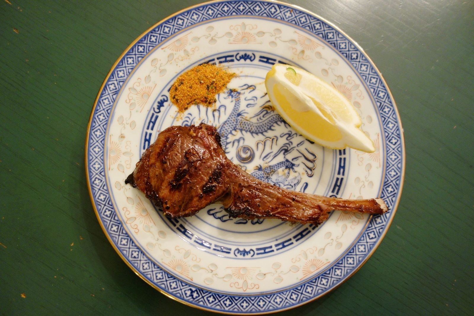 Marinated lamb chops served with a slice of lemon and Togarashi spice. Delicious!