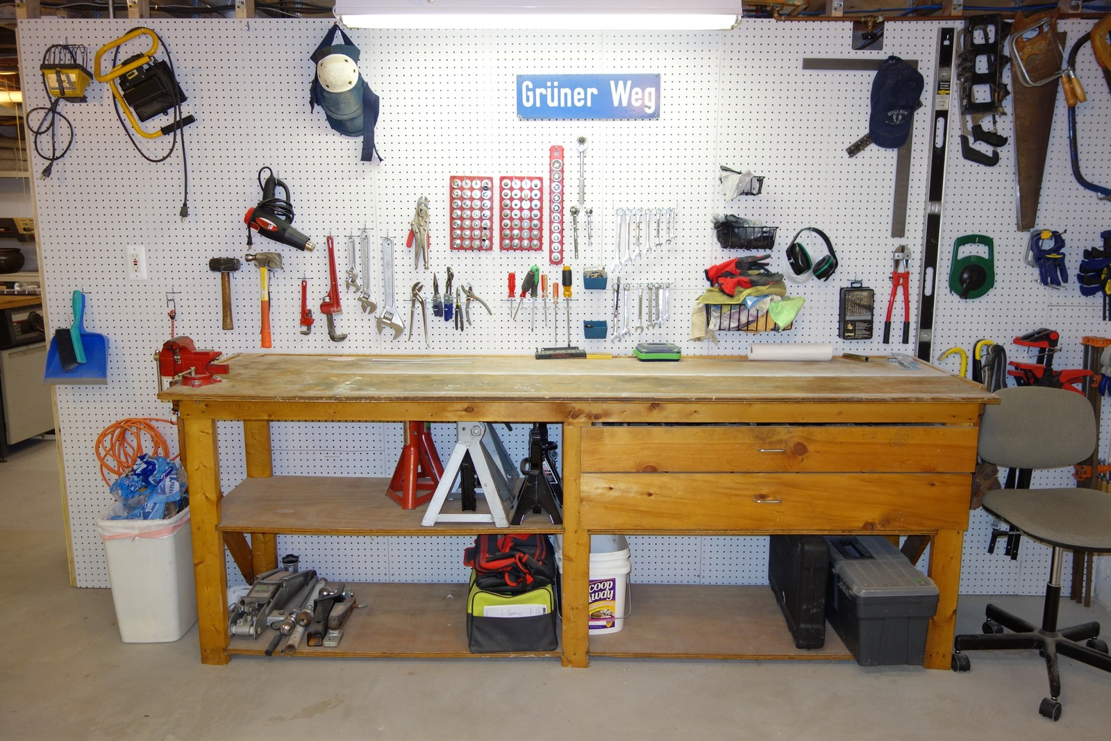 I used to store all of my tools in the drawers within the workbench, but would have to dig through each drawer to find them. HAving the tools on display on the wall makes finding and replacing them much faster.