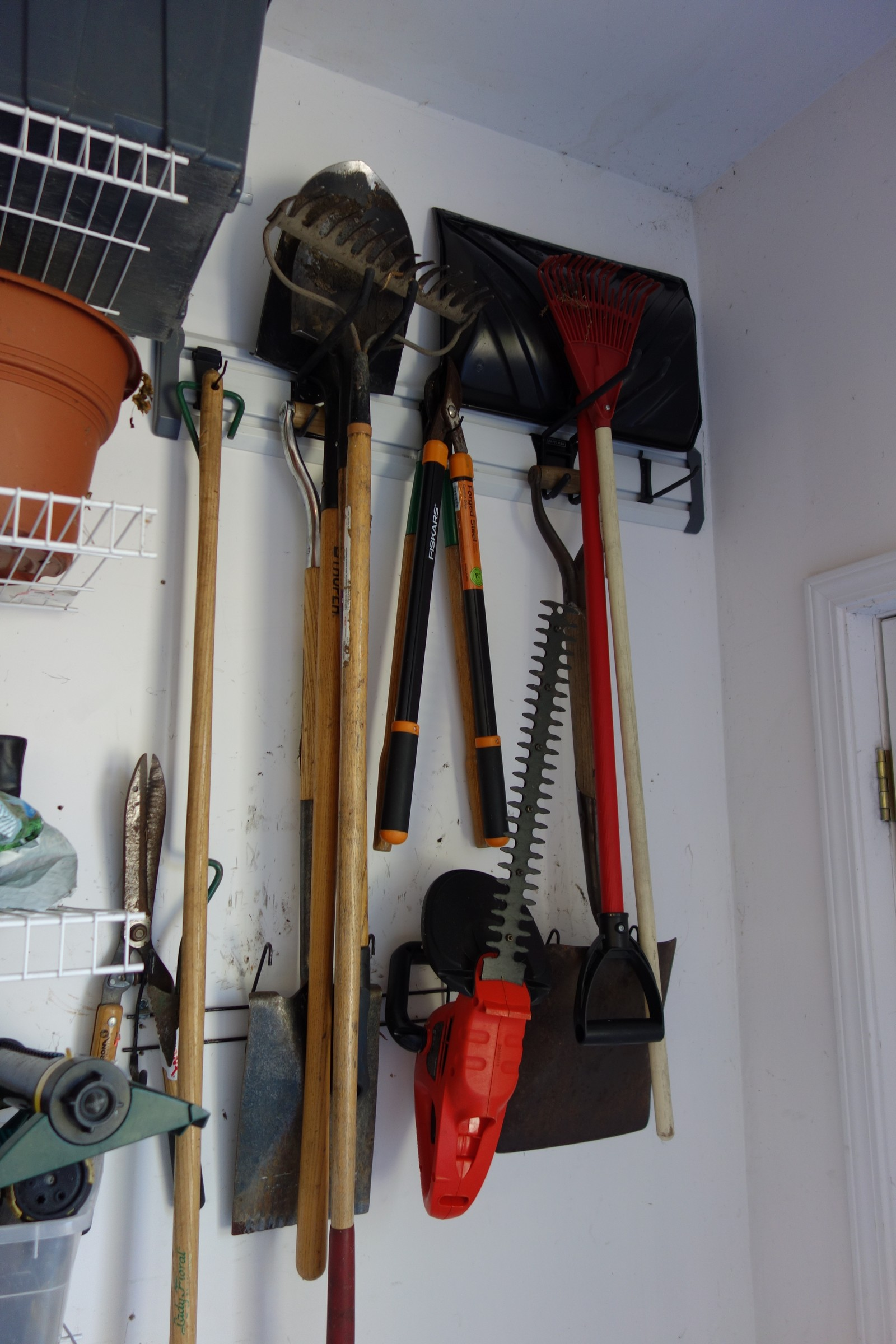GearTrack high on my garage wall holds a ton of yard tools, and let's me put my wheelbarrow against the wall below it.
