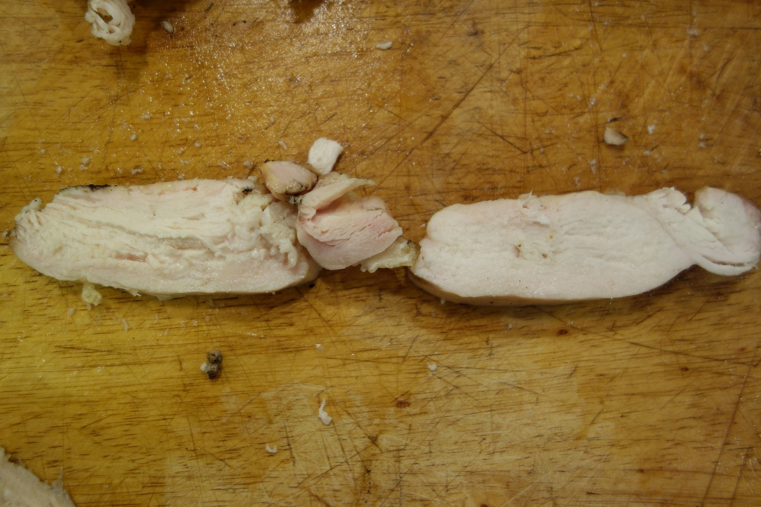 In this cross-section of the normal breasts, the wet-brined cut on the left is slightly taller than the dry-brined cut on the right. It is also juicier.  I did not notice any real degradation in flavor vs. the dry-brined breast on the right.