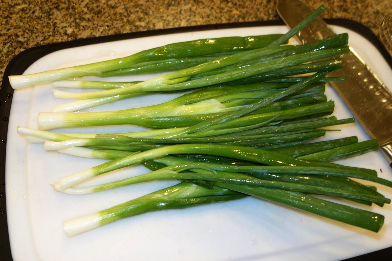 Clean the green onions.