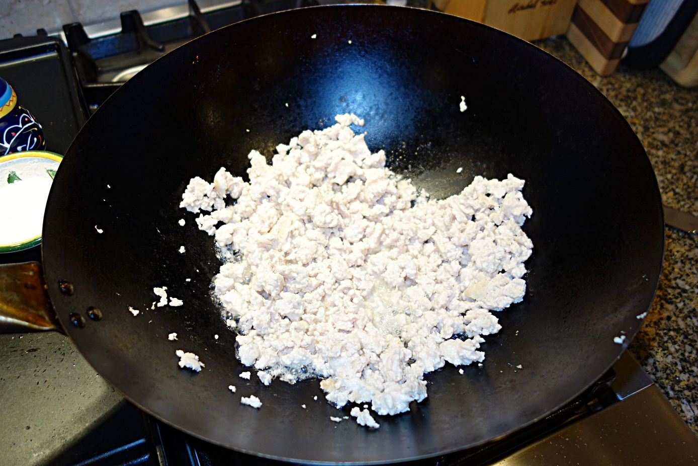 Cook the ground chicken, then drain it and set the chicken aside.