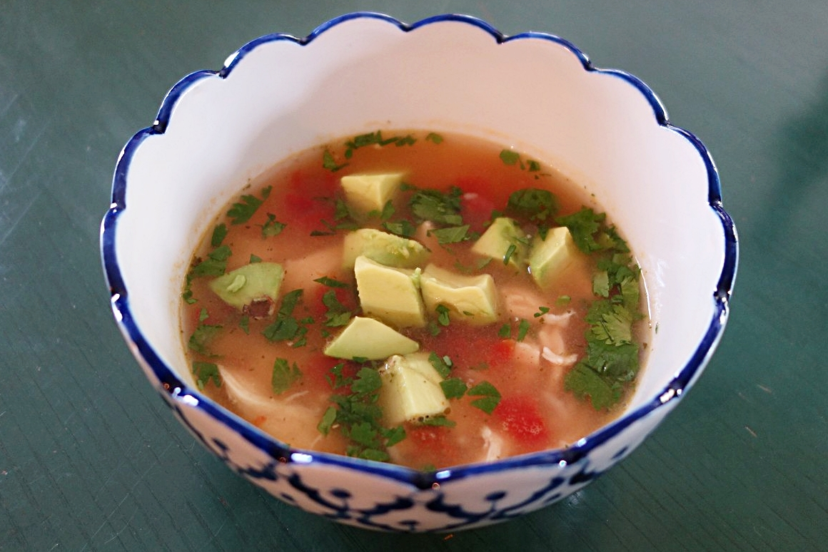 Topped with cilantro and sliced avocado, this soup is absolutely full of flavor.