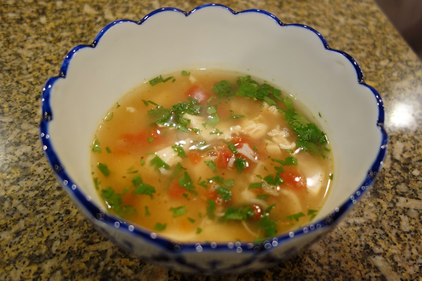 Cilantro added, ready for avocado. With chicken, rice, and tomatoes, This is a hearty soup!