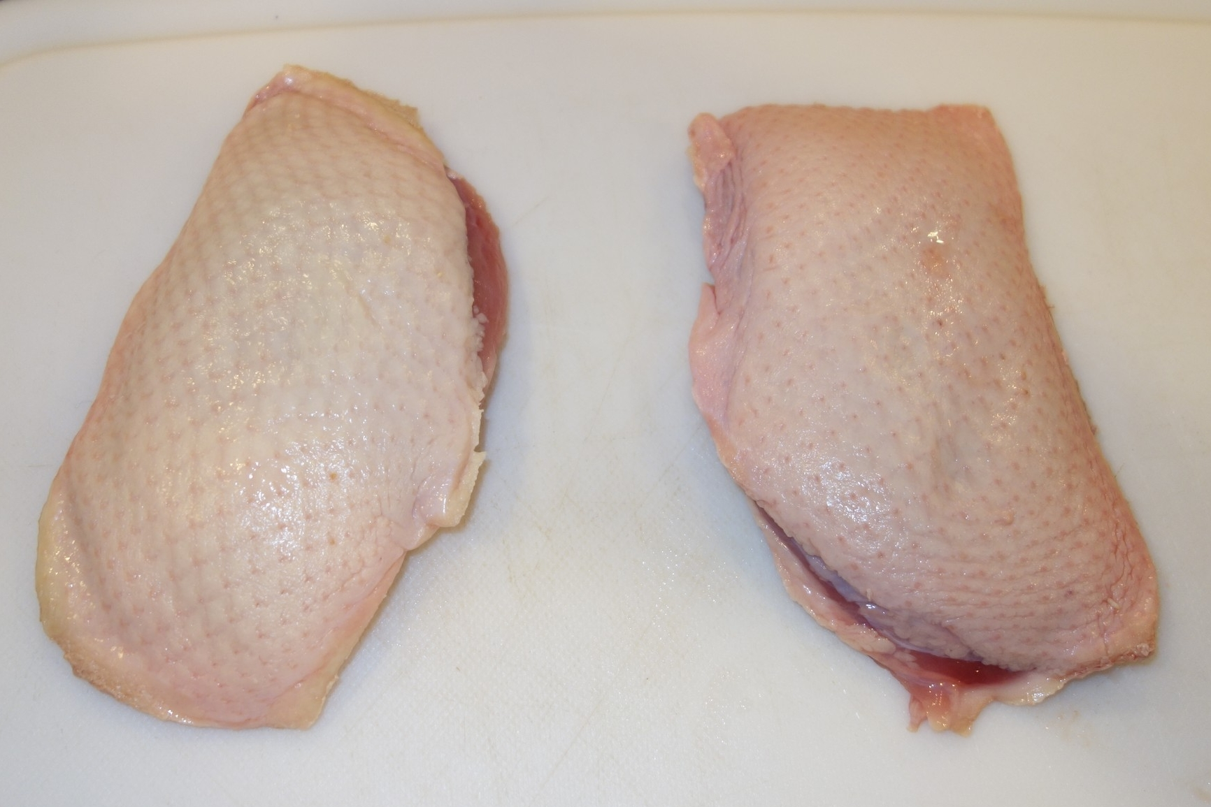 Drain the blood from the packets, then pat each breast dry with paper towels.