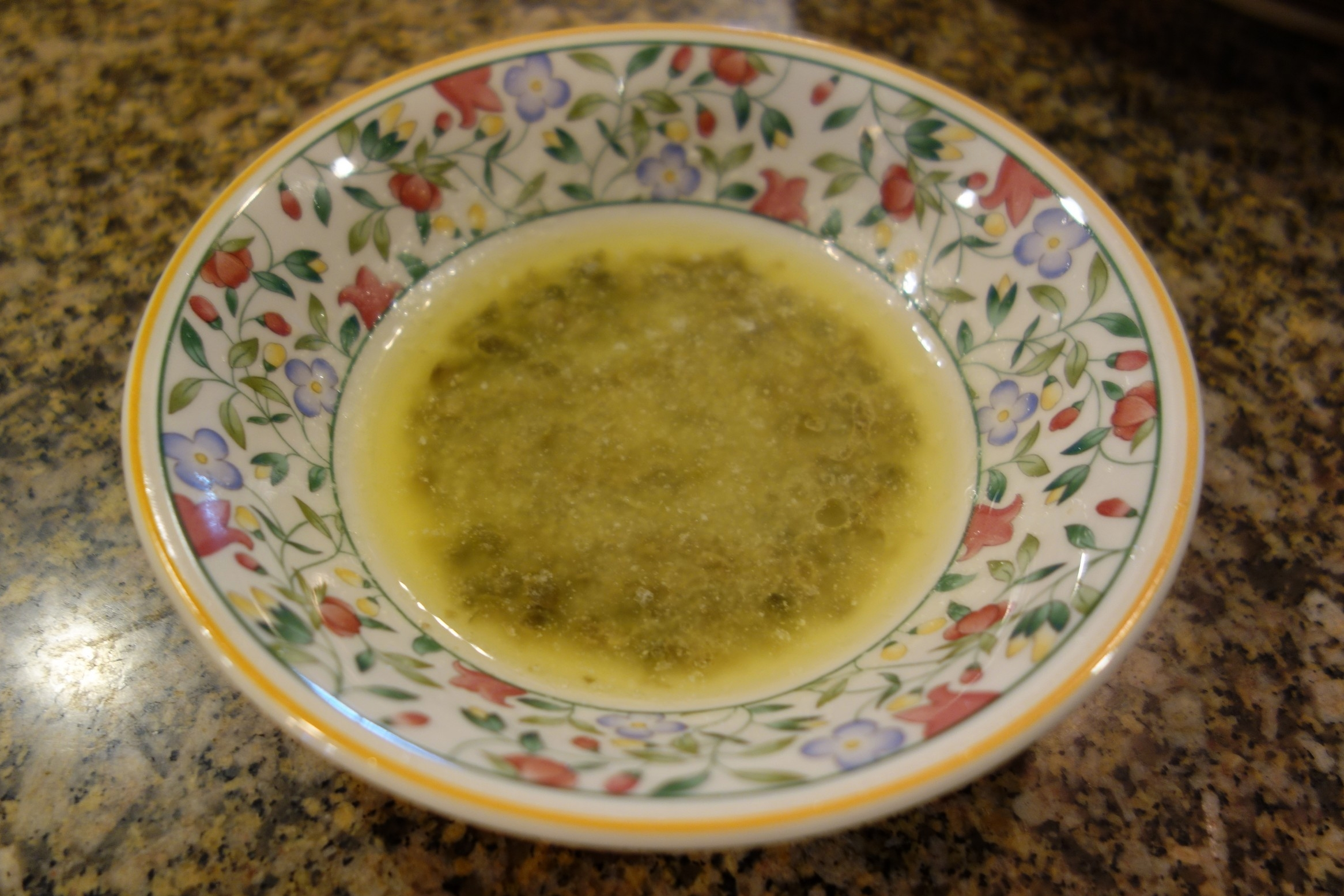 Get the sauce ready.  Melt 2 tbsp of real butter by microwaving it in a bowl, then add the minced capers and lemon juice.