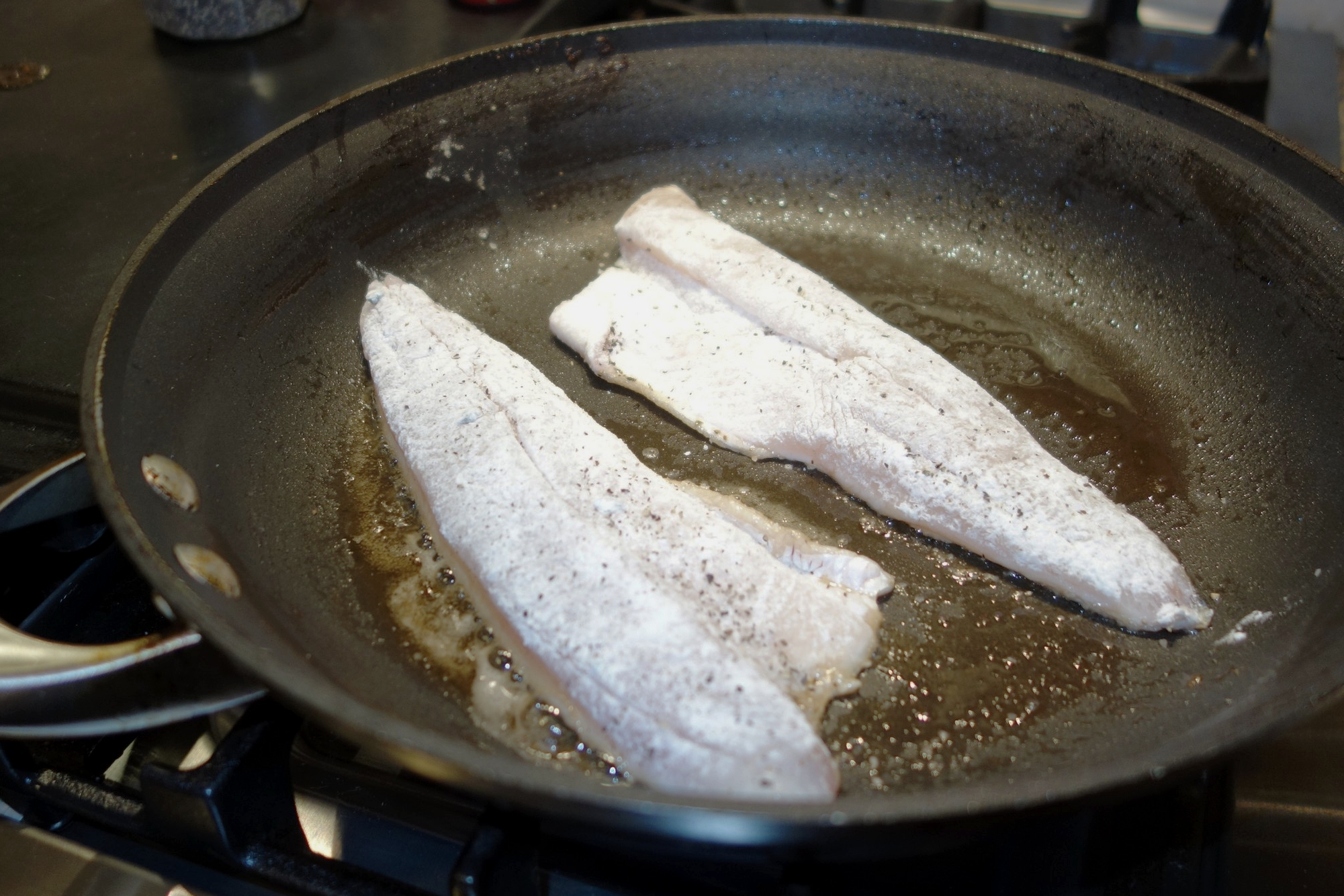 Cook the fish.  Wipe the pan out with paper towels and pour the clarified brown butter back in. Turn to medium high heat. When the butter is shimmering, add the fillets with skin facing down. Immediately reduce the heat to medium low.