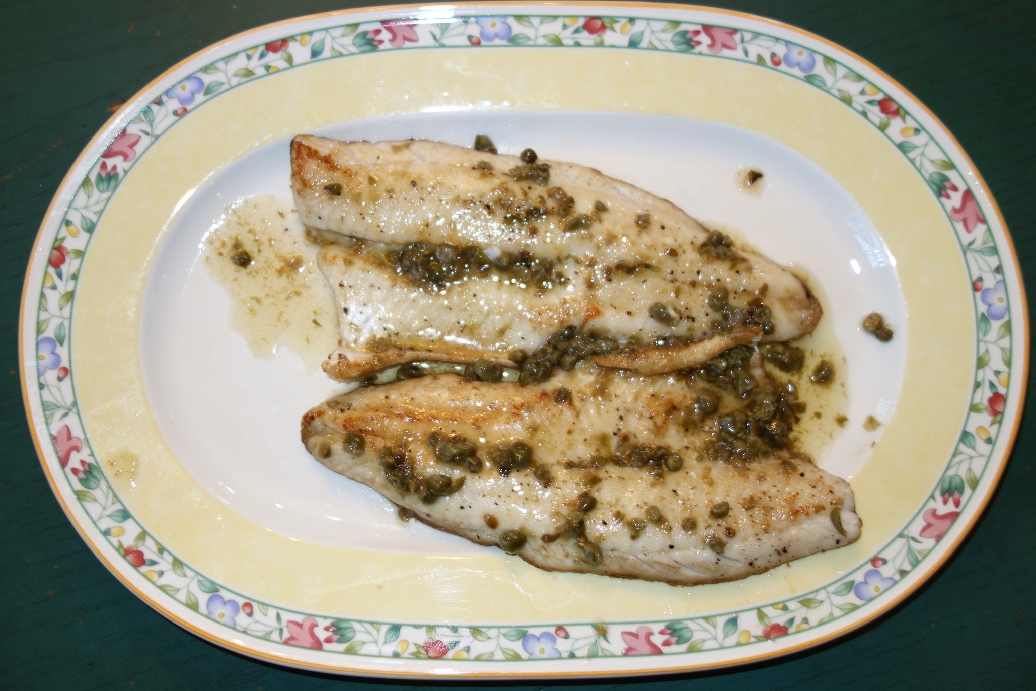Pour the sauce bowl into the remaining brown butter and drippings. Stir on medium heat until all brown.Move the fish to a serving platter,then pour the sauce over the fish and serve.