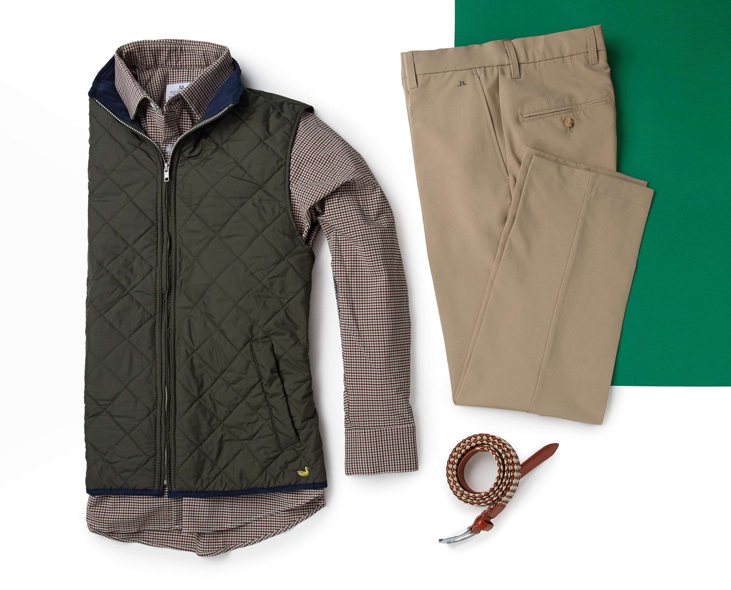 """For Travis' second Bogeybox, we included non-golf apparel. He requested casual items that can be worn out to at the bar with a few friends to watch the game. We added layering pieces that blend well with the four-way stretch button down.""   - Nik. Bogeybox Pro"