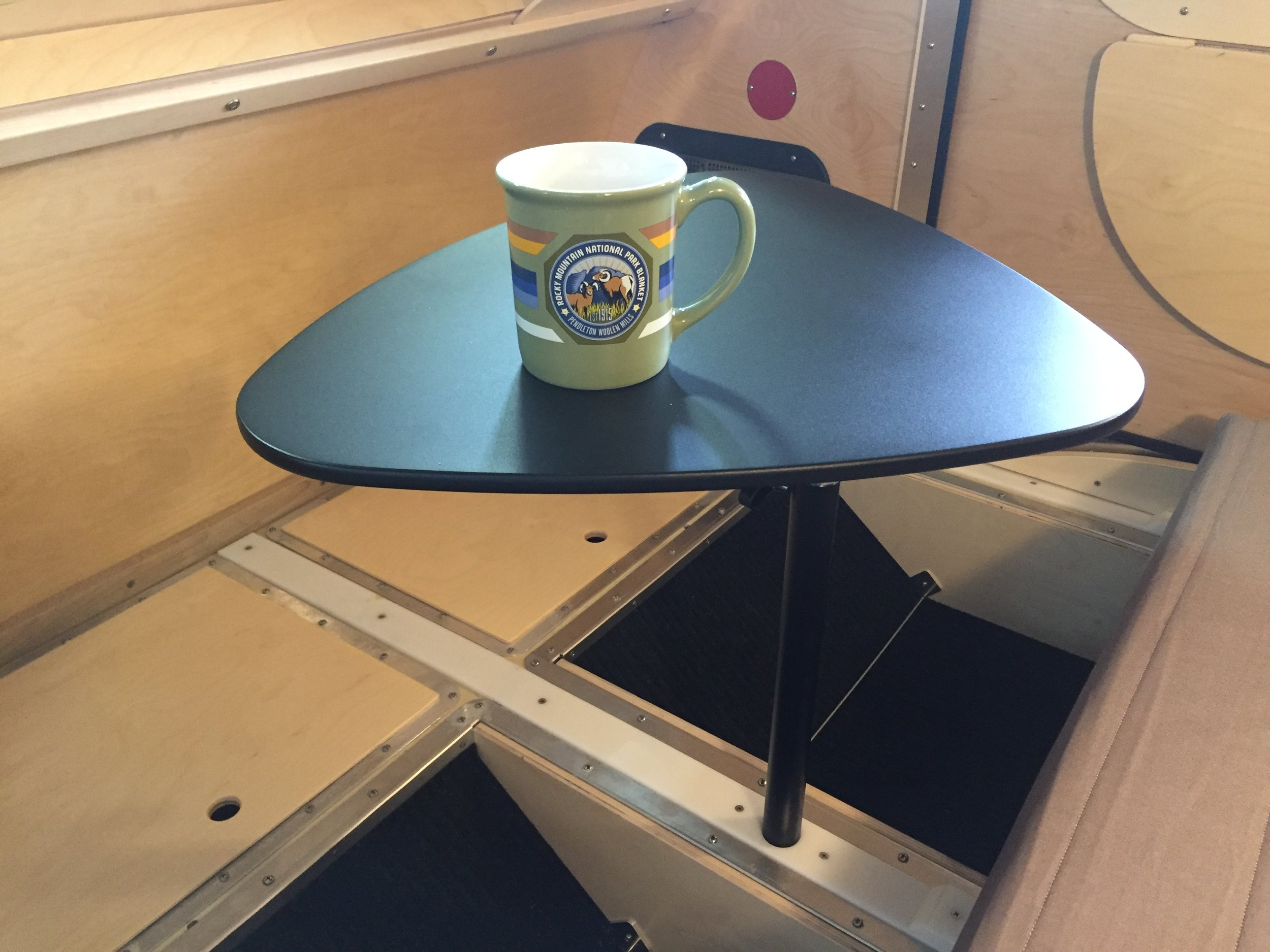Teardrop camper _ collapsable sofa table.jpg