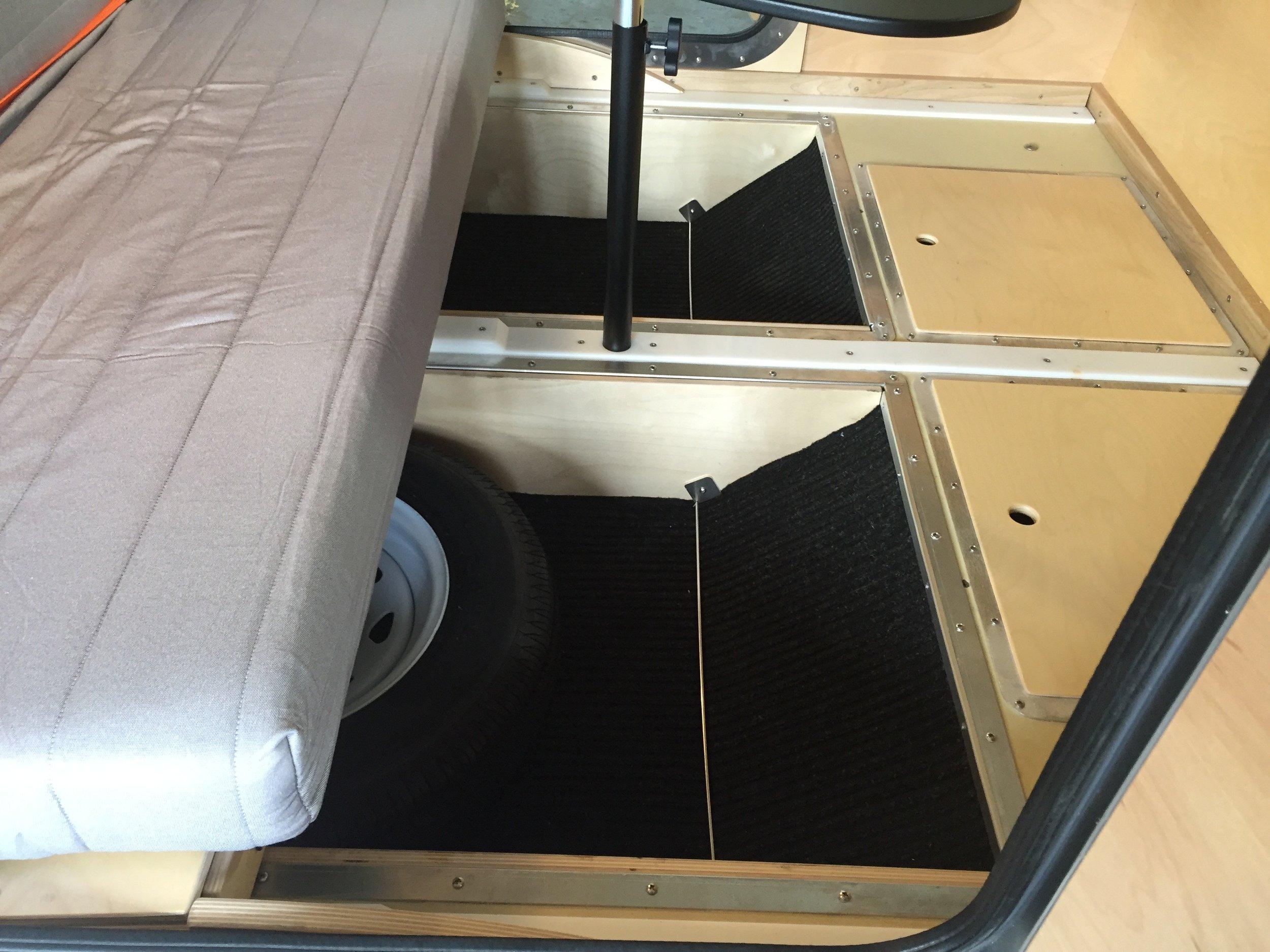 Teardrop camper _ under bed storage compartments.jpg