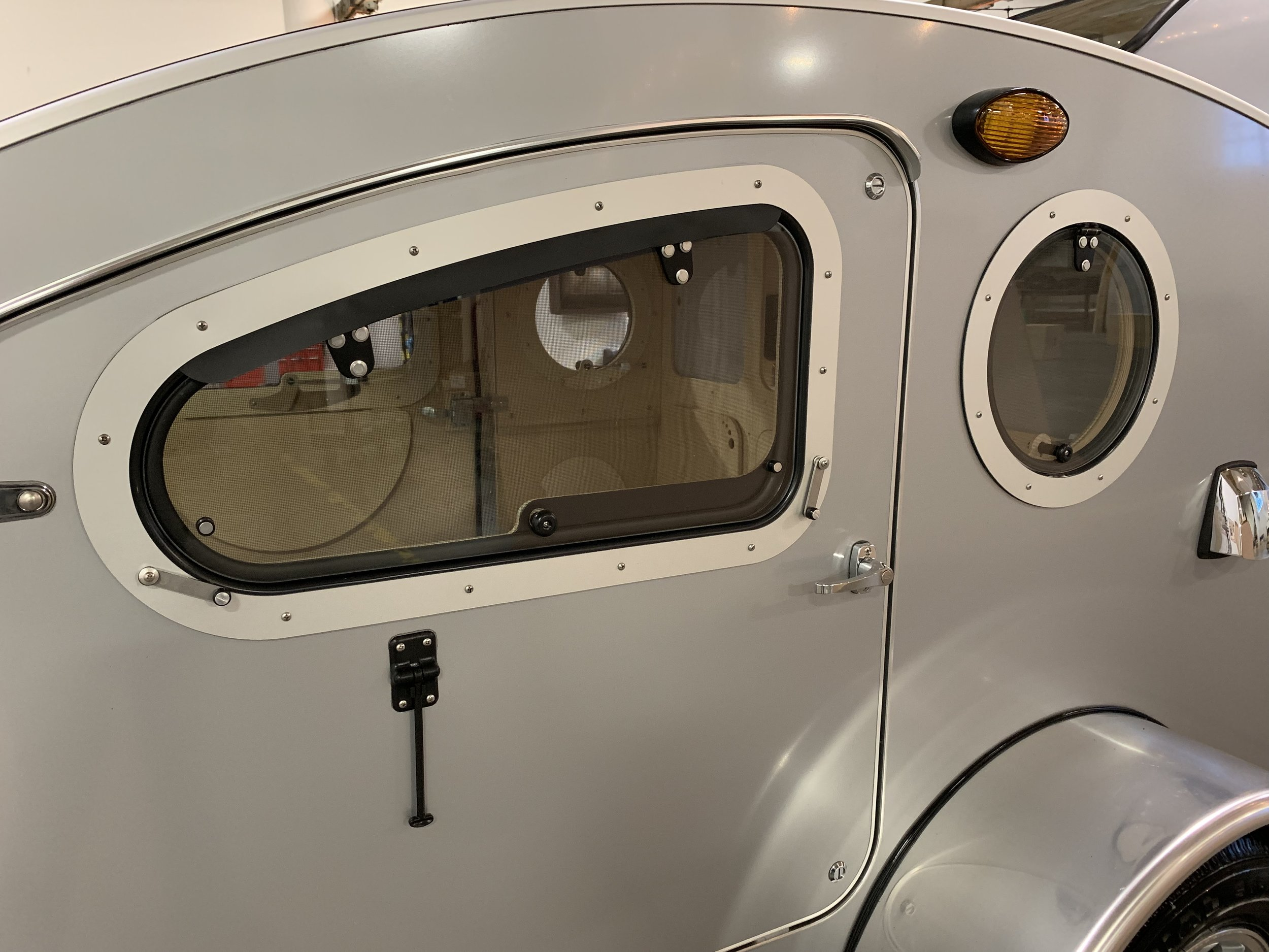 "- ""On Vistabule teardrops, you'll find larger custom-shaped doors with large windows on both sides of the camper."""