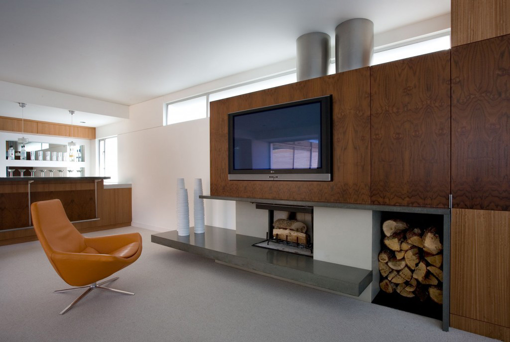 The upper family room /  bar.  A blend of woods and concrete to warm you up.