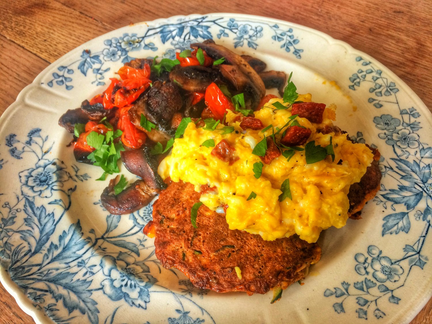 Courgette & corn fritters with chorizo scrambled eggs and grilled mushrooms and tomatoes- completely grain free and filling.