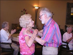 Residents dance to the piano tunes at Happy Hour, a weekly affair.