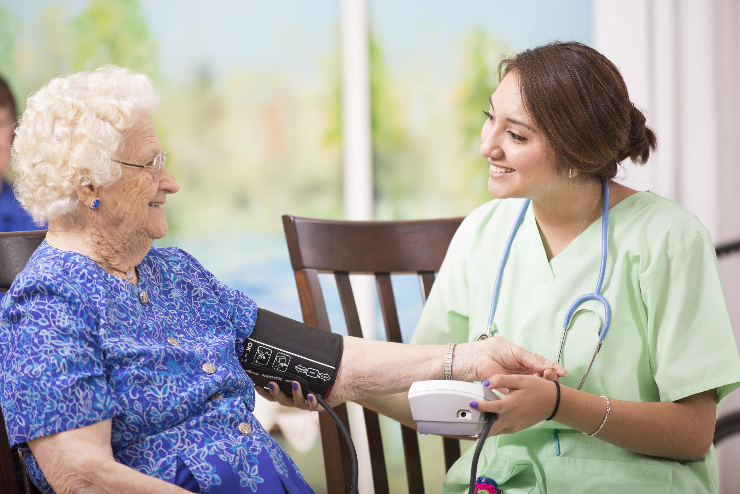 iStock-Home healthcare nurse checks blood pressure516281881.jpg