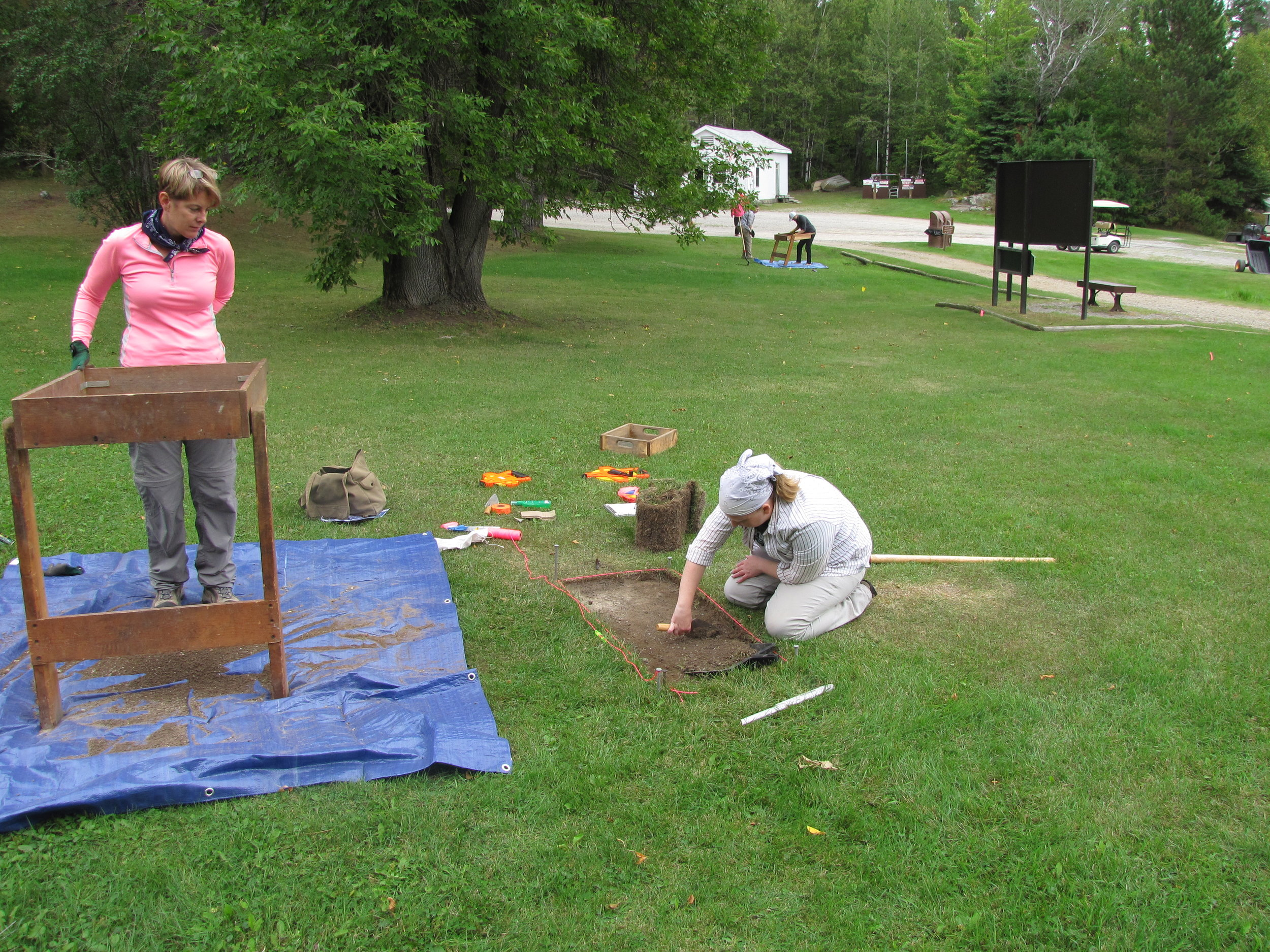 NPS Archeologists from Lincoln, Nebraska carefully excavate layers of soil in 2016 to recover any preserved information related to Chris Monson's trading post. One Test Unit is in the foreground; a second Test Unit can be seen in the background.
