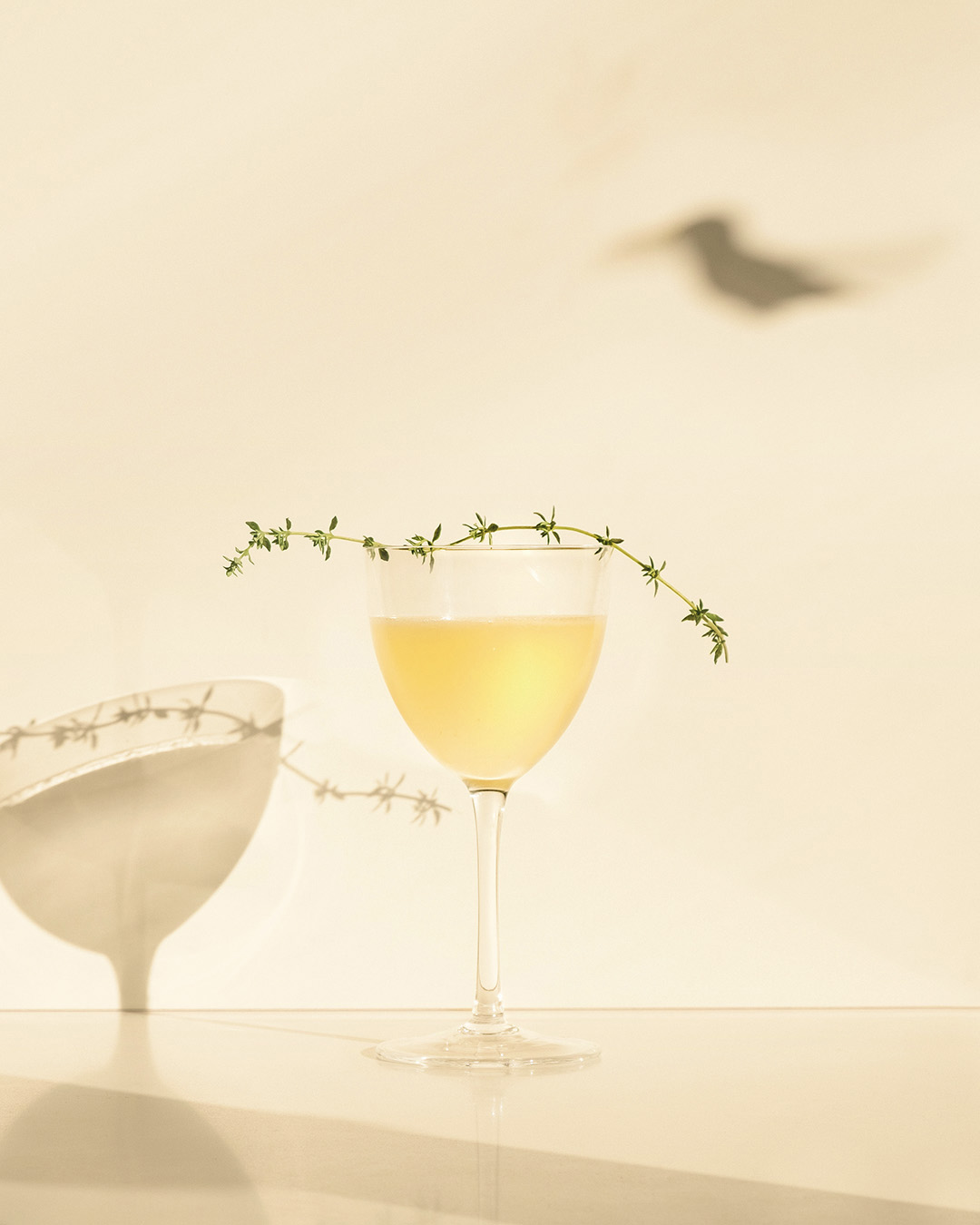 BEE'S KNEES   2  oz  Pomp & Whimsy ¾  oz  lemon juice ½  oz  honey syrup*   Combine in a cocktail shaker filled with ice and shake until chilled. Strain into a Nick and Nora glass.    Garnish with expressed lemon peel and a sprig of thyme that has been gently rubbed between the fingers to release its oils.    *Honey syrup is made with a 1:1 ratio of honey and water