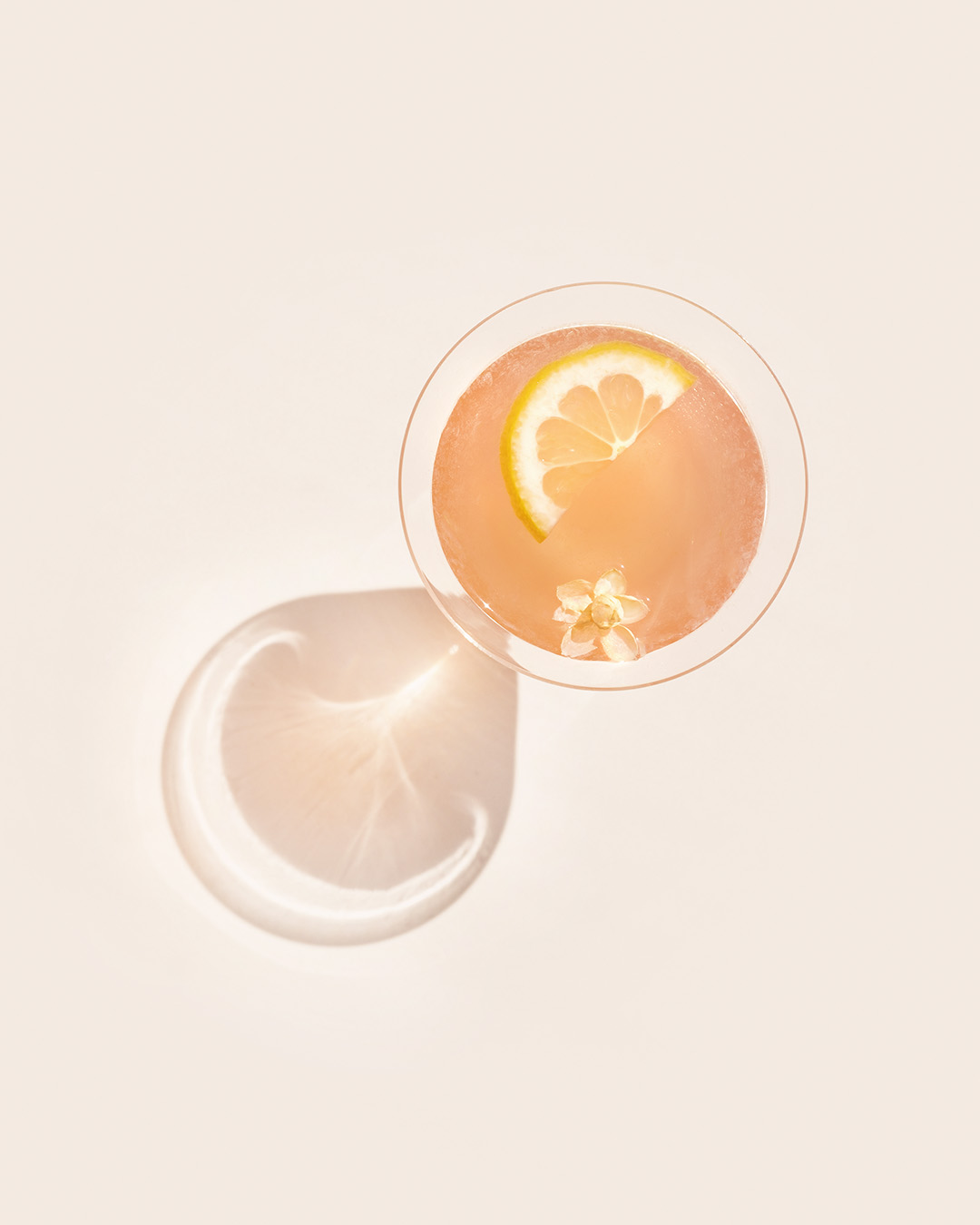 JASMINE PEARL   1¼  oz  gin ¾  oz  Pomp & Whimsy 1  oz  lemon ¼  oz  Campari   Shake ingredients with ice. Strain into a chilled coupe or martini glass, and garnish with a lemon wheel and jasmine flower (dried or fresh).