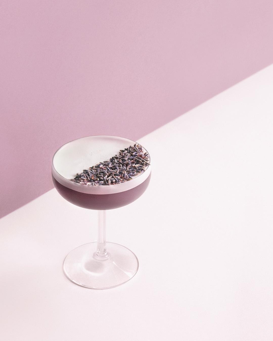 VIOLET FEMME   1½  oz  Pomp & Whimsy ½  oz  crème de violette/violet liqueur ½  oz  dry vermouth 1  tsp  grenadine 1  oz  egg white dried lavender buds   Dry shake, wet shake, strain.    Garnish with lavender buds.